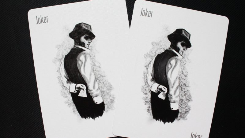 Two Joker Playing Cards, featuring an ominous person representing an email spammer.